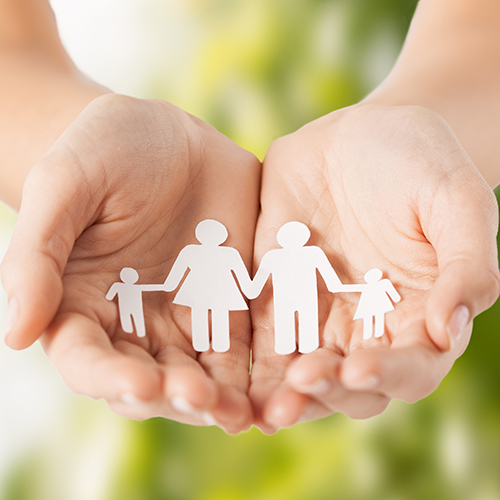 eco, bio, nature, love, harmony concept - woman cupped hands showing paper man family