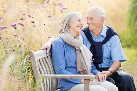 Older-couple-relaxing-on-park-bench