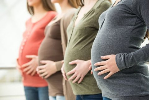 PROD-Pregnant-women-lined-up-in-a-row