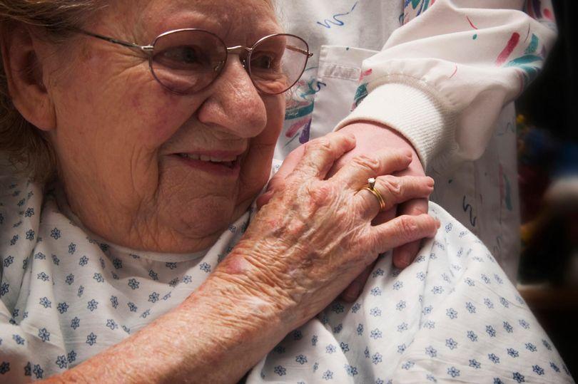 PROD-Nurse-touching-senior-womans-shoulder