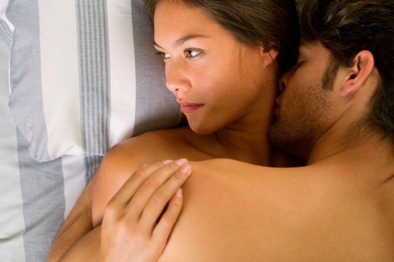 PROD-Young-couple-being-intimate-in-bed-woman-looking-away