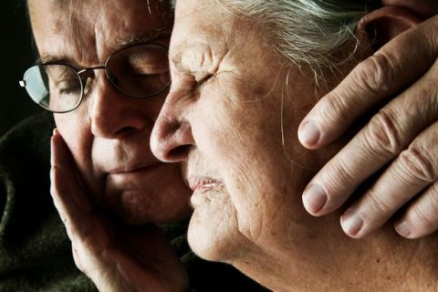 portrait-of-senior-couple-with-close-eyes-close-up