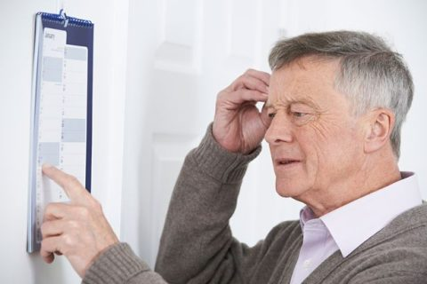 PROD-Confused-Senior-Man-With-Dementia-Looking-At-Wall-Calendar